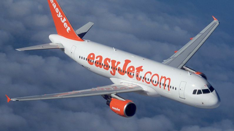Damage caused by an errant Champagne cork forced the pilot of an easyJet plane to make an emergency landing.