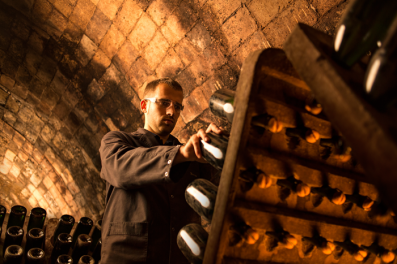 Turning bottles during the riddling process. Recaredo
